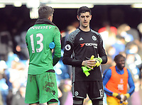 Football - 2016 / 2017 Premier League - Chelsea vs. Crystal Palace<br /> <br /> Crystal Palace hero Wayne Hennessey is congratulated by fellow goalkeeper Thibault Courtois at the final whistle at Stamford Bridge.<br /> <br /> COLORSPORT/ANDREW COWIE