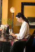 Woman works on her laptop in a cafe. Photographed in Tel Aviv Israel