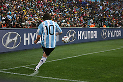 Lionel Messi of Argentina  takes a corner kick