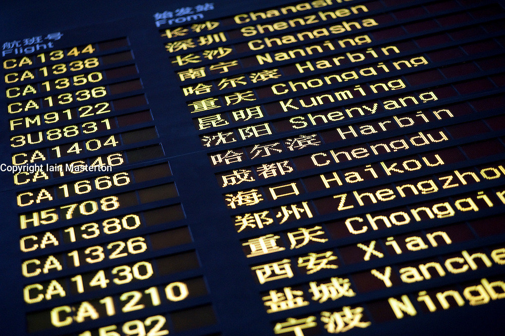 Detail of domestic arrival information board at new Terminal 3 in Beijing International Airport in China