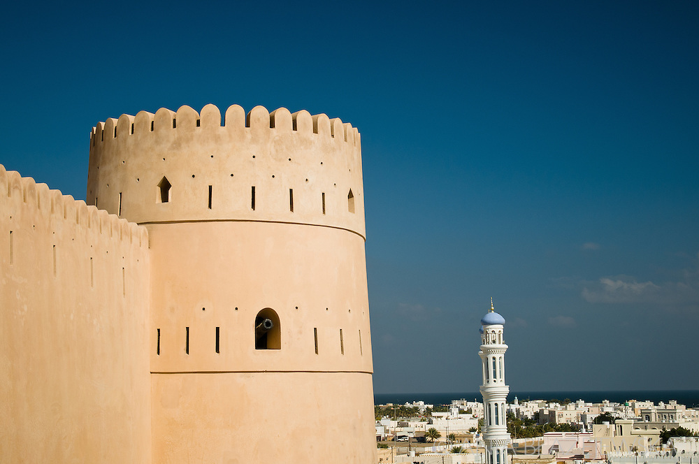 Oman, Sur. Sunaysilah Fort and the new district of Sur.