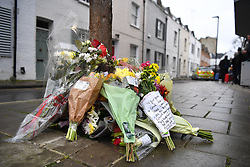© Licensed to London News Pictures. 08/03/2019. Fulham, London, UK. Flowers are left in tribute to 17yr old Ayub Hassan who died of stab wounds sustained in an attack in West Kensington yesterday afternoon. Four teenagers have been arrested in connection with the murder, the investigation continues. Photo credit: Guilhem Baker/LNP