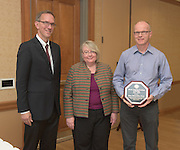From left: Joseph Shields, Vice President for Research & Creative Activity and Dean of Ohio University's Graduate College along with Pam Benoit, Executive Vice President and Provost, congratulate Klaus Himmeldirk for being the winner of the Provost's Award for Excellence in Teaching during the 2016 Faculty Awards Recognition Ceremony held at Baker Center on Tuesday, September 6, 2016.