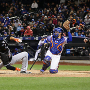 NEW YORK, NEW YORK - APRIL 12: Giancarlo Stanton, Miami Marlins, avoids a high pitch from Jim Henderson, New York Mets, as catcher Travis d'Arnaud  catches the ball during the Miami Marlins Vs New York Mets MLB regular season ball game at Citi Field on April 12, 2016 in New York City. (Photo by Tim Clayton/Corbis via Getty Images)
