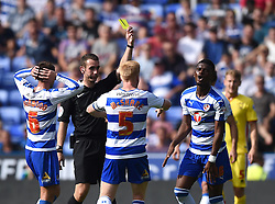 Aaron Tshibola of Reading is shown a yellow card by referee David Coote - Mandatory by-line: Paul Knight/JMP - Mobile: 07966 386802 - 22/08/2015 -  FOOTBALL - Madejski Stadium - Reading, England -  Reading v MK Dons - Sky Bet Championship
