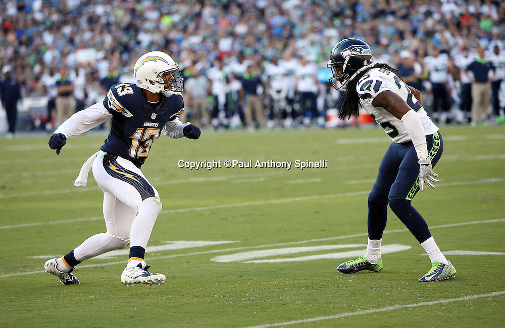San Diego Chargers wide receiver Keenan Allen (13) goes out for a pass while defended by Seattle Seahawks cornerback Richard Sherman (25) during the 2015 NFL preseason football game against the Seattle Seahawks on Saturday, Aug. 29, 2015 in San Diego. The Seahawks won the game 16-15. (©Paul Anthony Spinelli)