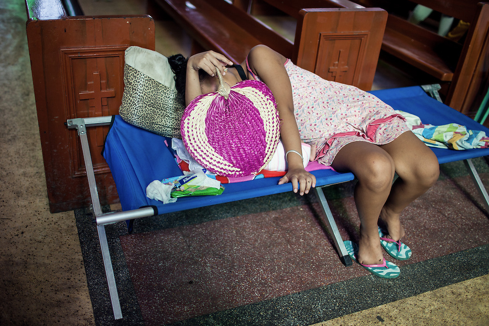A mother naps with her baby inside the Redemptiorist Church that serves as a temporary shelter.
