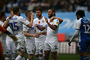 Leeds United midfielder Kemar Roofe (7) scores a goal 1-2 and celebrates during the EFL Sky Bet Championship match between Wigan Athletic and Leeds United at the DW Stadium, Wigan, England on 4 November 2018.