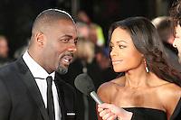Idris Elba; Naomie Harris, The Royal Film Performance; Mandela: Long Walk to Freedom, Odeon Leicester Square, London UK, 05 December 2013, Photo by Richard Goldschmidt