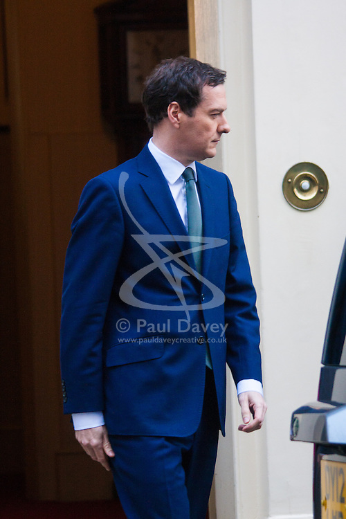 Downing Street, London, January 27th 2015. Ministers attend the weekly cabinet meeting at Downing Street. PICTURED: Chancellor George Osbourne leaves  numbver 11.