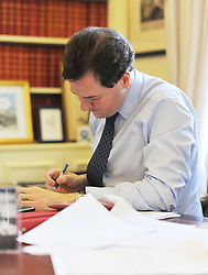 Chancellor of the Exchequer George Osborne working at his desk on his 2012 budget on Budget morning in his office of No11 Downing Street before presenting his annual budget to Parliament, Wednesday March 21, 2012 in London, England. Photo By Andrew Parsons/ i-Images.Minimum Charge £200