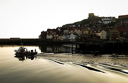 © Licensed to London News Pictures. <br /> 09/04/2017<br /> Whitby, UK. <br />  <br /> A fishing boat heads out into the North Sea at first light from the harbour in Whitby in North Yorkshire. <br /> <br /> <br /> Photo credit: Ian Forsyth/LNP