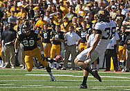 September 29 2012: Minnesota Golden Gophers punter Christian Eldred (38) kicks the ball away during the first quarter of the NCAA football game between the Minnesota Golden Gophers and the Iowa Hawkeyes at Kinnick Stadium in Iowa City, Iowa on Saturday September 29, 2012. Iowa defeated Minnesota 31-13 to claim the Floyd of Rosedale Trophy.