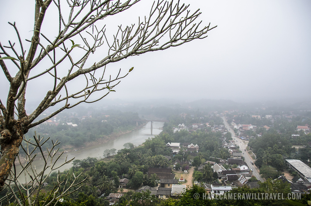 The view over Luang Prabang from Wat Phra That Chomsi at the top of a hill in Luang Prabang, Laos. The Buddhist temple was originally built in 1804 and is reached by a 328-step staircase up the side of the hill.