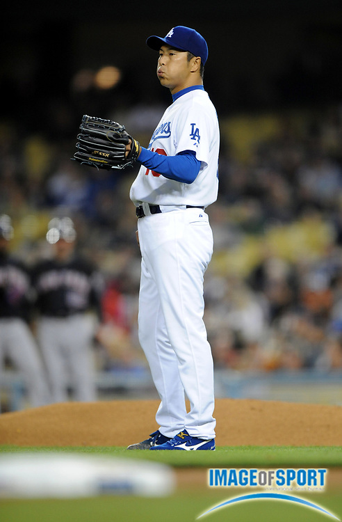 May 6, 2008; Los Angeles, CA, USA; Los Angeles Dodgers starter Hiroki Kuroda (18) reacts after surrendering a first-inning home run against the New York Mets at Dodger Stadium.