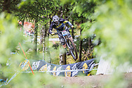Remi Thirion takes flight during his race run at the UCI Mountain Bike World Cup in Fort William.