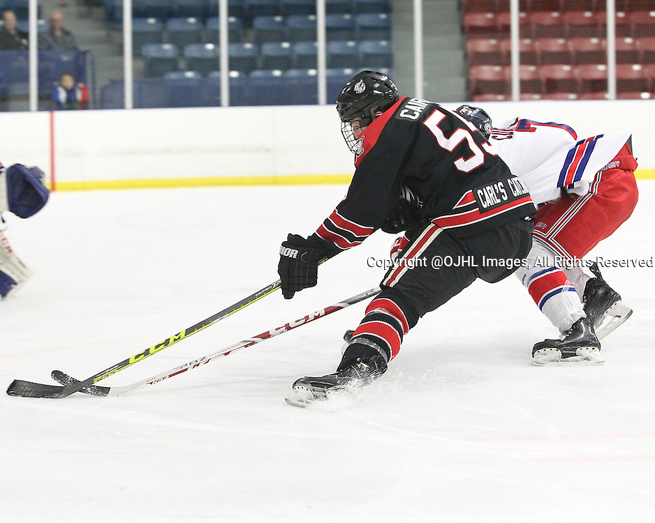 NORTH YORK, - Mar 27, 2016 -  Ontario Junior Hockey League game action between Georgetown Raiders and North York Rangers. Game 6 of the semi final playoff series. At the Herbert Carnegie Centennial Arena, ON. Matthew Cairns #55 of the Georgetown Raiders keeps the puck from the Georgetown Raiders player during the third period.<br /> (Photo by Tim Bates / OJHL Images)