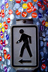 Stock photo of a pedestrian crosswalk sign covered in stickers at the Museum of Fine Arts in Houston Texas