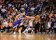 Dec. 17, 2012; Phoenix, AZ, USA; Phoenix Suns guard Goran Dragic (1) attempts to steal the ball from Sacramento Kings guard Aaron Brooks (3) in the second half at US Airways Center. The Suns defeated the Kings 101-90.  Mandatory Credit: Jennifer Stewart-USA TODAY Sports