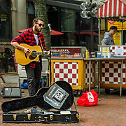 We were strolling around Faneuil Hall in Boston on a Saturday morning. Brian Stankus was performing and doing a wonderful job. He is definitely worth giving a listen (BrainStankus.com). I've shared the images I took with him.