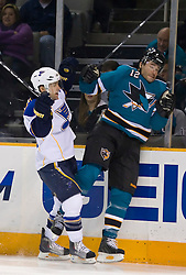 January 6, 2010; San Jose, CA, USA; St. Louis Blues center Andy McDonald (10) checks San Jose Sharks center Patrick Marleau (12) into the boards during the first period at HP Pavilion. San Jose defeated St. Louis 2-1 in overtime. Mandatory Credit: Jason O. Watson / US PRESSWIRE