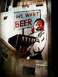 Propaganda style graffiti adverts for beer consumption in Zone 9, Hanoi, Vietnam, Southeast Asia
