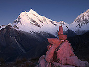 Sunset on the west face of Chopicalqui 6,354m with the southwest ridge on the right skyline, and the north face of Huascarán Sur (South) 6,768m (right).  Viewed from Pisco Base Camp 4,700m.