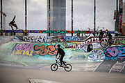 Skaters and BMX bikers in the Place de la Chapelle Skate Park in Brussels.