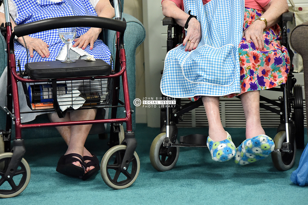 older people care  home zimmer frame slippers feet sitting caring residential care
