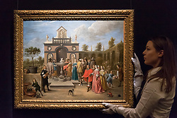 "© Licensed to London News Pictures. 01/12/2017. London, UK.  A technician presents ""An elegant company before a pavilion in an ornamental garden"", 1651, by David Teniers the Younger, (Est. GBP0.8-1.2m).  Preview of ""Masters of Light"", Sotheby's Old Masters Evening Sale which will take place on 6 December at Sotheby's, New Bond Street. Photo credit: Stephen Chung/LNP"