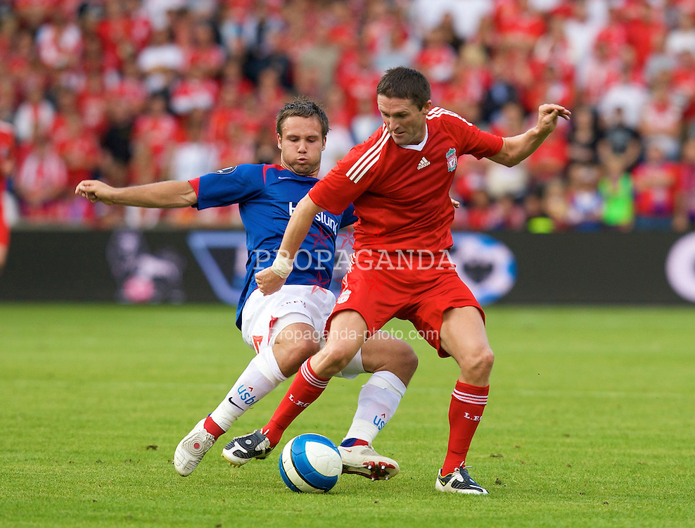 OSLO, NORWAY - Tuesday, August 5, 2008: Liverpool's Robbie Keane and Valerenga's Kristofer Haestad during a pre-season friendly match at the Ullevaal Stadion. (Photo by David Rawcliffe/Propaganda)