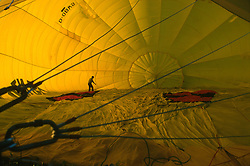 GERMANY SCHLESWIG-HOLSTEIN KIEL 9JUN02 - Pilot Andreas Kuehl unfurls the balloon's hull from the inside, while air is blown into it...jre/Photo by Jiri Rezac..© Jiri Rezac 2002..Contact: +44 (0) 7050 110 417..Mobile:  +44 (0) 7801 337 683.Office:  +44 (0) 20 8968 9635..Email:   jiri@jirirezac.com.Web:     www.jirirezac.com