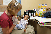 American speech Pathologist Kelly Mabry feeds three month old Cesar Vangu...Operation Smile South Africa.Clinique Ngaliema, Avenue Des Cliniques.KInshasa, DRC Mission, June 3rd-12th 2011..© Zute & Demelza Lightfoot.www.lightfootphoto.com...