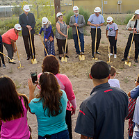 Dignitaries and school staff and students participate in a groundbreaking ceremony for a new school building at Lincoln Elementary School in Gallup Monday.
