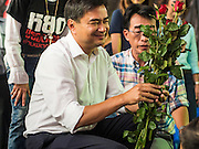 05 AUGUST 2013 - BANGKOK, THAILAND: Former Thai Prime Minister ABHISIT VEJJAJIVA greets his supporters at a Thai Democrats' event in Bangkok Monday. Abhisit spoke at a gathering of Thai Democrats in a working class neighbohood of Bangkok off of Rama VI Road. He spoke out against the Pheu Thai's amnesty efforts, which could lead to Thaksin Shinawatra returning to Thailand.     PHOTO BY JACK KURTZ