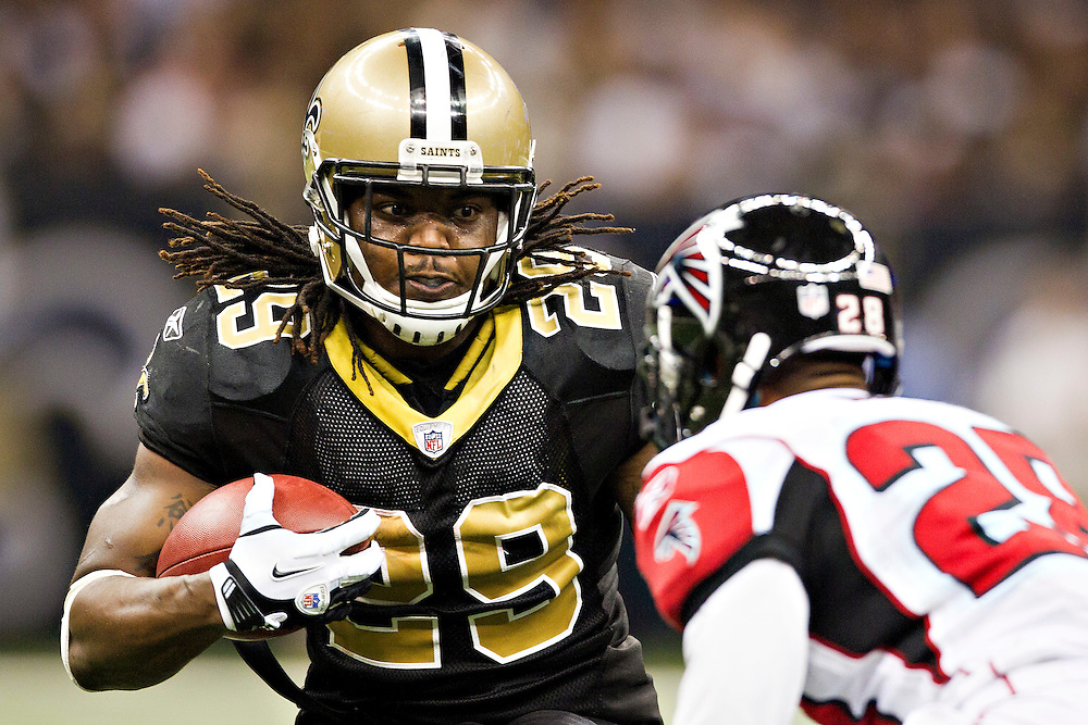 NEW ORLEANS, LA - DECEMBER 26:   Chris Ivory #29 of the New Orleans Saints runs the ball against the Atlanta Falcons at Mercedes-Benz Superdome on December 26, 2011 in New Orleans, Louisiana.  The Saints defeated the Falcons 45-16.  (Photo by Wesley Hitt/Getty Images) *** Local Caption *** Chris Ivory
