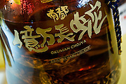 "Photo shows ""habushu,"" the awamori-based liquor that includes extracts of the highly venomous habu snake, at Oknawa World in Naha, Okinawa Prefecture, Japan, on May 22, 2012. One habushu on display was 70 percent proof awamori is selling for 350,000 yen. Photographer: Robert Gilhooly"