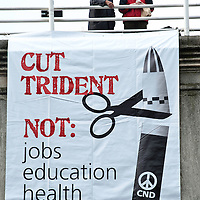 London, UK - 20 October 2012: a banner reads 'Cut Trident not jobs education health' during the TUC-organised march 'A future that works' against austerity cuts in central London.