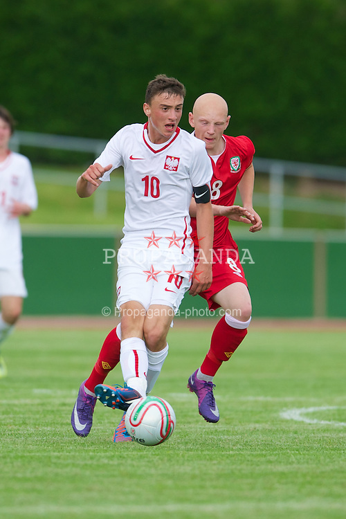 COLWYN BAY, WALES - Tuesday, August 28, 2012: Poland's captain Filip Jagiello and Wales' Lloyd Humphries during the International Friendly Under-16's match at Eirias Park. (Pic by David Rawcliffe/Propaganda)