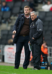 MILTON KEYNES, ENGLAND - Easter Monday, April 9, 2012: Milton Keynes Dons' manager Karl Robinson and assistant John Gorman during the Football League One match against Tranmere Rovers at the Stadium MK. (Pic by David Rawcliffe/Propaganda)