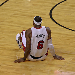 Jun 19, 2012; Miami, FL, USA; Miami Heat small forward LeBron James (6) reacts after getting a leg cramp during the fourth quarter in game four in the 2012 NBA Finals against the Oklahoma City Thunder at the American Airlines Arena. Mandatory Credit: Derick E. Hingle-US PRESSWIRE