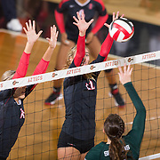 27 August 2016: The San Diego State Aztecs took on the Michigan State Spartans in game two of the Aztec Invitational at Peterson Gym on the campus of SDSU. MB Emma Fuzie (12) goes up for a block in the second set against the Spartans. The Aztecs lost 3-1 to the Spartans. www.sdsuaztecphotos.com
