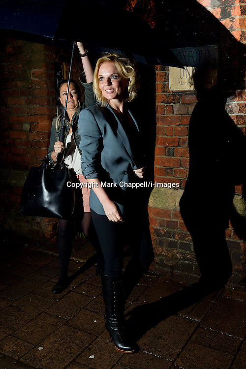 Former Spice Girl Geri Halliwell leaves The Oxford Union, sheltered from the rain by her assistant, having addressed the student members of the world renown debating club. Oxford, UK. Monday 11th June 2012.<br /> Photo Credit: Mark Chappell/i-Images<br /> &copy; Mark Chappell/i-Images 2012. All Rights Reserved. See instructions