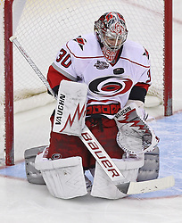 Feb 16; Newark, NJ, USA; Carolina Hurricanes goalie Cam Ward (30) makes a save during the third period at the Prudential Center. The Devils defeated the Hurricanes 3-2.