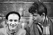 Neville and Friend by a Brick Wall, High Wycombe, UK, 1980s.
