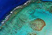 Waves breaking on the New Caledonia Barrier Reef (the second longest double-barrier reef in the world, a UNESCO World Heritage Site) off Noumea on Grand Terre, New Caledonia.