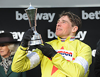 National Hunt Horse Racing - 2020 Cheltenham Festival - Wednesday, Day Two (Ladies Day)<br /> <br /> Winner, Harry Skelton on Politologue with the trophy  in the 15.30 Betway Queen Mother Champion Steeple chase (Grade 1), at Cheltenham Racecourse<br /> <br /> COLORSPORT/ANDREW COWIE