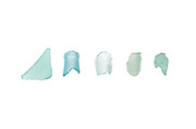 Five pieces of aqua beach glass on a white background.