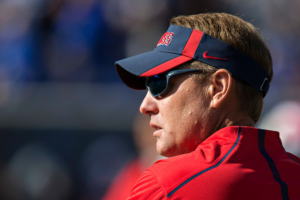 MEMPHIS, TN - OCTOBER 17:  Head Coach Hugh Freeze of the Ole Miss Rebels watches his team warm up before a game against the Memphis Tigers at Liberty Bowl Memorial Stadium on October 17, 2015 in Memphis, Tennessee.  The Tigers defeated the Rebels 37-24.  (Photo by Wesley Hitt/Getty Images) *** Local Caption *** Hugh Freeze