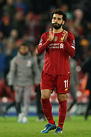 Football - 2019 / 2020 UEFA Champions League - Round of Sixteen, Second Leg: Liverpool (0) vs. Atletico Madrid (1)<br /> <br /> Liverpool's Mohamed Salah looks upset as he applauds the Liverpool fans at the end of the match, at Anfield.<br /> <br /> <br /> COLORSPORT/TERRY DONNELLY